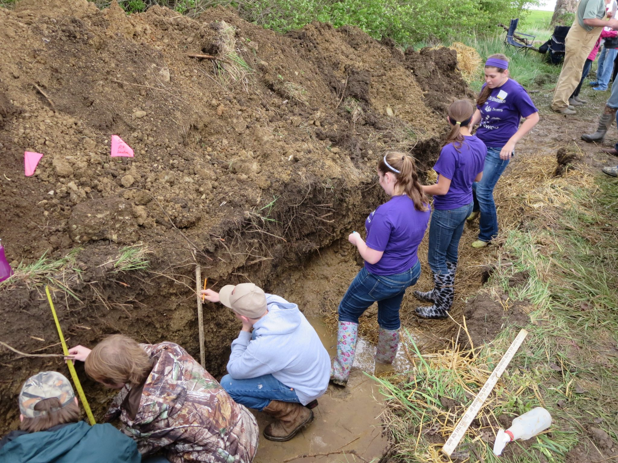 2014 PW soils, youth in a trench meassuring the depth of trench